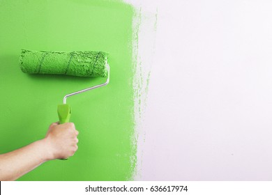 Close-up , the painter paint the wall of the room.