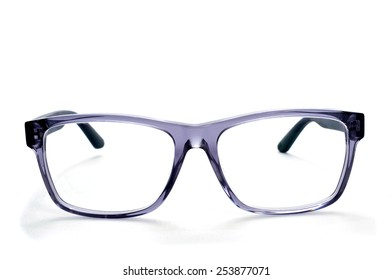closeup of a pair plastic rimmed eyeglasses on a white background