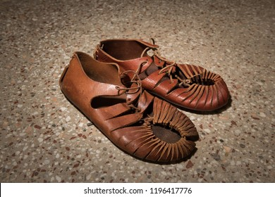 Closeup of a pair of roman sandals made of leather