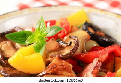 Closeup of pan fried vegetables and mushrooms