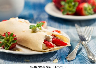 Closeup of pancakes with fresh fruits