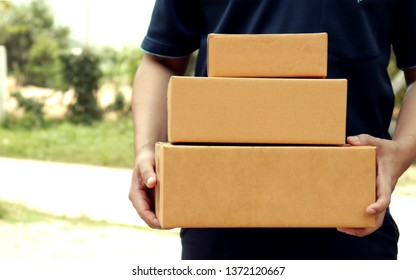 Closeup parcel in hand, package delivery service providers with outdoor copy area