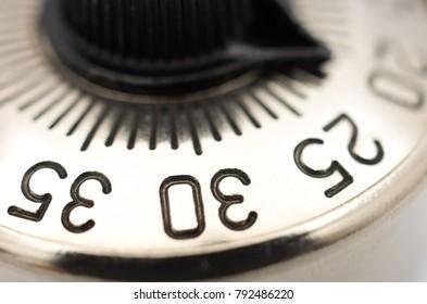 Closeup of part of a metal circular dial combination padlock
