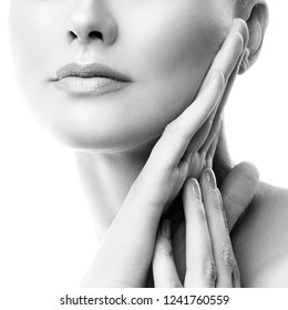 Close-up part of woman face with lips, neck and hands of beauty girl model. Natural nude makeup, clean fresh skin on white background. Skincare health concept. Black and white