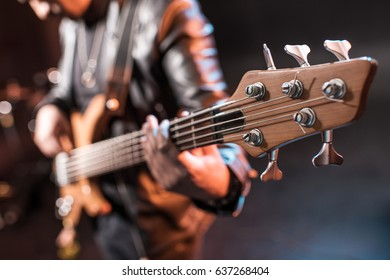 Close-up partial view of rock star playing hard rock music on stage