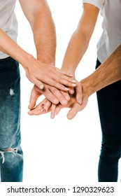 close-up partial view of young friends stacking hands isolated on white