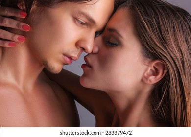 Close-up of a passionate couple on a white background