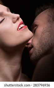 Close-up of passionate man kissing woman's neck