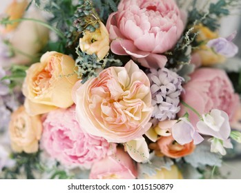 Closeup of a Pastel Colored Wedding Bouquet with Pink and Yellow Flowers