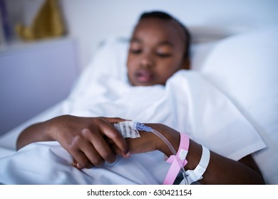 Close-up of patient sleeping on the bed at hospital