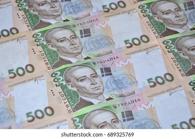 A close-up of a pattern of many Ukrainian currency banknotes with a par value of 500 hryvnia. Background image on business in Ukraine