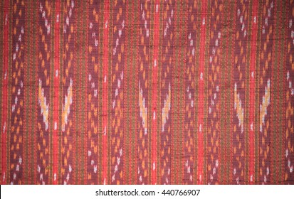 Closeup pattern of Thai fabric background