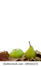 Close-up of pears with autumn leaves against white background
