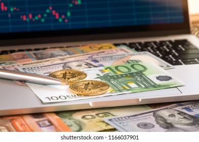 Close-up pen on EUR banknote and coin vintage tone, Business concept a pen with coin and money, Trade forex concept on keyboard and monitor