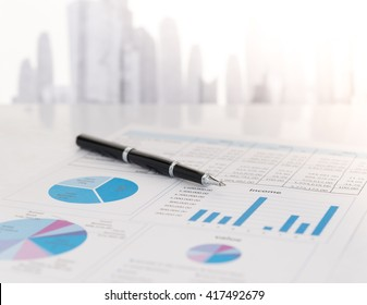 Close-up pen on financial report. Concept of  Data Analysis, Investment Planning, Business Analytics.