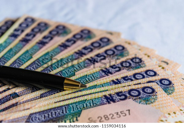 Closeup Pen On Nigerian Naira Notes Stock Photo (Edit Now) 1159034116