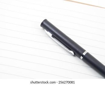 Closeup a pen on notebook