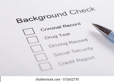 Close-up Of Pen Over Background Check Form