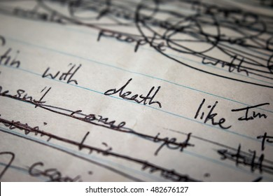 """Closeup of pen writing on paper. Focus on the word """"death"""""""