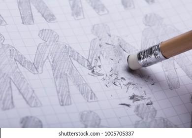 Close-up Of Pencil Eraser Erasing Drawn Figures On Paper