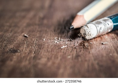 Closeup of pencil eraser on wooden table, soft focus. Business Mistake erase concept.