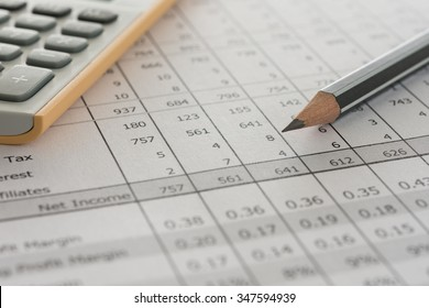 closeup pencil  on financial statement on auditor's desk. accounts concept.