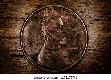 Close-up of penny on hardwood table