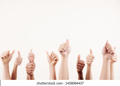 Close-up of people gesturing thumbs up and showing success isolated on white background