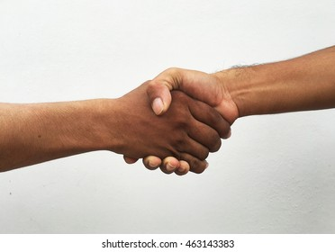 Closeup of people shaking hands on the white background.
