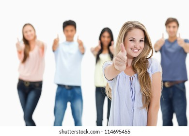 Close-up of people smiling and approving with one woman in foreground against white background
