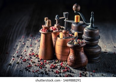 Closeup of pepper mills with different types of pepper