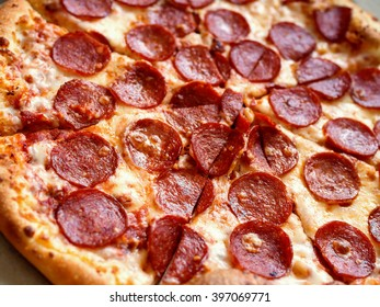 Close-up of pepperoni pizza, shallow depth of field