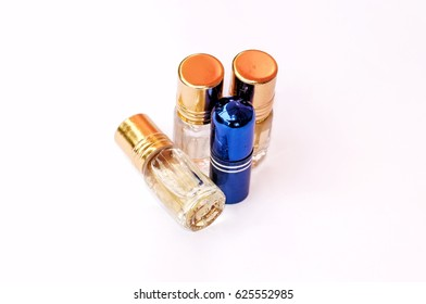 Close-up perfumes on white background. Selective focus.