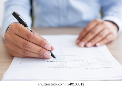 Closeup of Person Completing Application Form