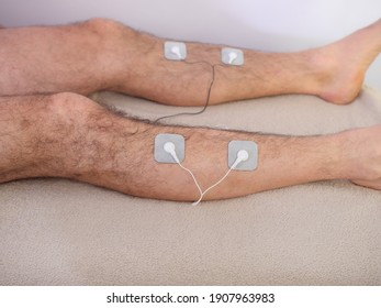Closeup Of A Person With Electrodes On A Leg - Shutterstock ID 1907963983