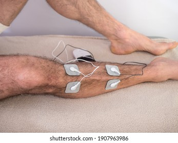 Closeup Of A Person With Electrodes On A Leg - Shutterstock ID 1907963986