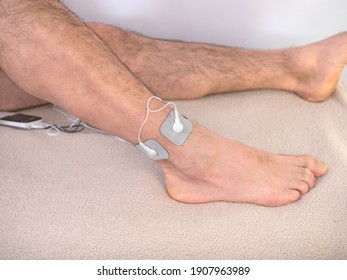 Closeup Of A Person With Electrodes On A Leg - Shutterstock ID 1907963989