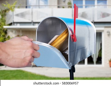 Close-up Of A Person Hand Checking Mailbox Outside The House