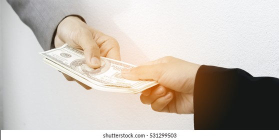 Close-up Of Person Hand Giving Money To Other Hand, hand to hand money pass