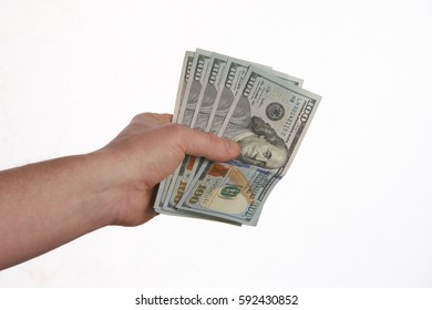 Close-up Of Person Hand Giving US dollar banknotes money. Ð¡oncept of salary.