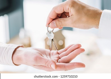 Close-up Of A Person Handover Keys To Man