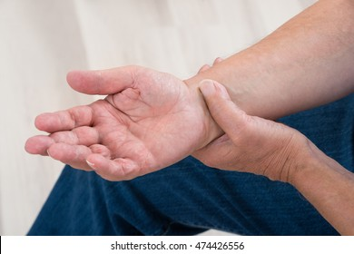 Close-up Of A Person Holding Painful Wrist