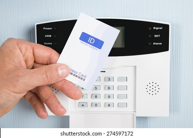 Close-up Of A Person Holding Security Card To Open Door. Photographer owns copyright for card design