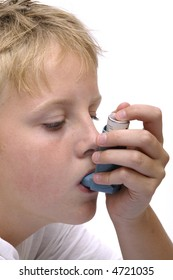 Close-up of a person inhaling medicine.