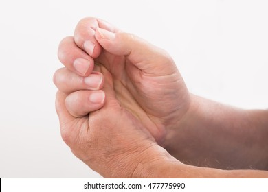 Close-up Of A Person Pressing His Palm With Thumb