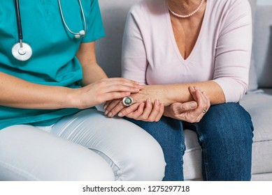 Close-up of person touching hand of senior woman. Caregiver in the nursing home. Elderly female hand holding hand of young caregiver at nursing home.Geriatric doctor or geriatrician concept.