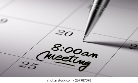 Closeup of a personal agenda with a Ballpoint pen marking a day of the month representing a schedule. 8am Meeting text note reminder concept. Words 8am Meeting written in Black Marker.