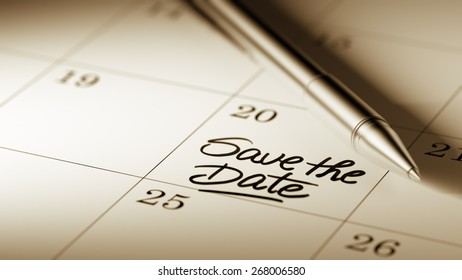 Closeup of a personal agenda with a Ballpoint pen marking a day of the month representing a schedule. Save the date text note reminder concept. Words Save the date written in Black Marker.