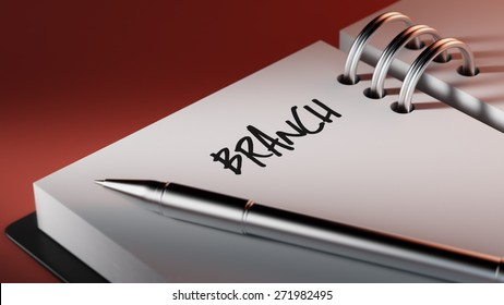 Closeup of a personal agenda setting an important date writing with pen. The words Branch written on a white notebook to remind you an important appointment.