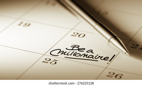 Closeup of a personal agenda setting an important date written with pen. The words Be a millionaire written on a white notebook to remind you an important appointment.